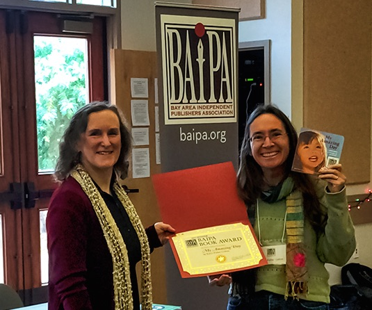 BAIPA President, Becky Parker Geist presents Karin Fisher-Golton with the BAIPA Book Award: Children's Picture Book Category. (Photo by Judy Baker, Brandvines)
